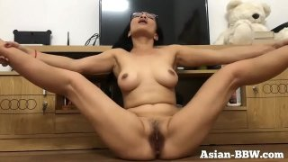 Asian MILF Rubs Hairy Pussy  more at AsianBBW.com